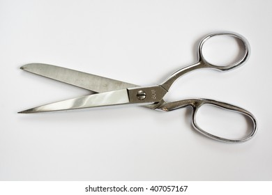 Metal Sewing Scissors Half Open Isolated on White