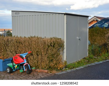 Metal Shed System for Garbage Collection Containers at the Access to the Parking Lot of a modern Multi Family Apartment Building