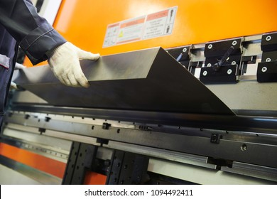 metal sheet bending machine at work in factory