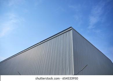 Metal sheet building with vivid sky