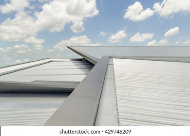 metal sheet roof on commercial construction with blue sky