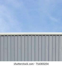 Metal sheet roof and wall steel with louver build factory and warehouse with blue sky.