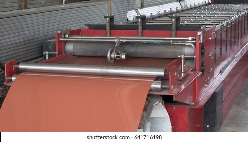 Metal Sheet tile manufacturing factory. Steel sheet with Zinc coated metal is rolled by  profiling forming machine.