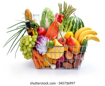 Metal shopping basket with groceries / studio photography of steel wire supermarket shopping carts basket with foodstuff - isolated on white background