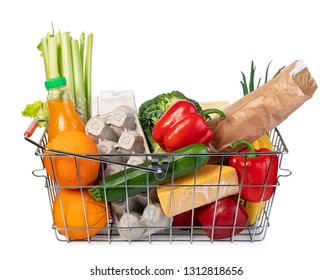 metal shopping basket with of grocery products isolated on white