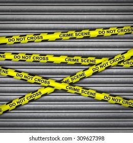 Metal shutter with crime scene police tape.