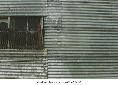 Metal siding of old Building with Windows