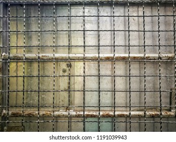 metal sieve background, iron mesh texture, close up steel cage detail, old warhouse metal door