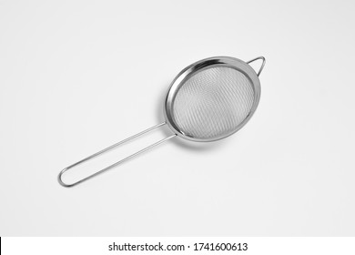 Metal sieve colander isolated on white background.Metallic strainer with handle. High resolution photo.