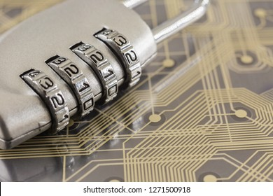 Metal silver padlock with 4 digit combination lock put on plastic digital circuit board, gold line background. Electronic data, cyber security and information privacy concepts.