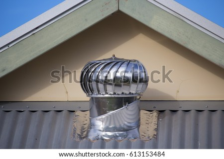 metal silver spinning turbine ventilators commonly known as whirlybirds roof vents installed in the - Turbine Roof Vents