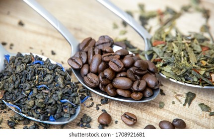 metal silver spoon wood wooden desk table dried tea leaves leaf plant green tea heap pile stack dried fruits coffee seeds black coffee bean roasted espresso caffeine cafe grain background front view