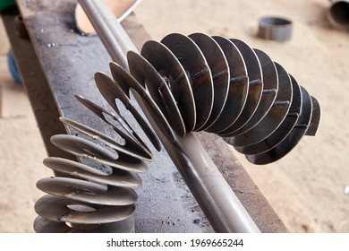 metal spiral before winding on the shaft for auger manufacturing