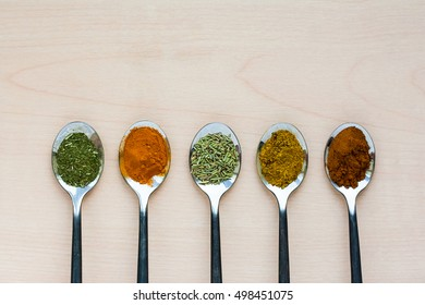 metal spoons, spices, herbs