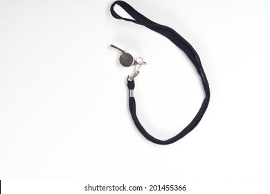 Metal sport coaches whistle with lanyard isolated on a white background with copy space