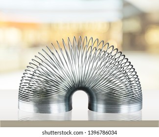 Metal Spring in an Arc Position Isolated on a White Background