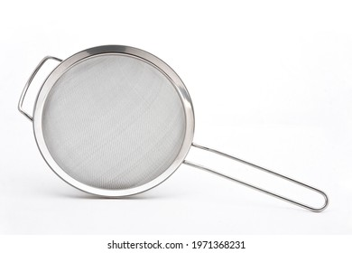 Metal or stainless-steel kitchen strainer, kitchen tool, isolated on white background with space for text