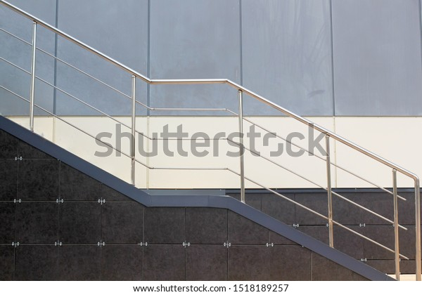 metal-stair-railing-on-background-600w-1