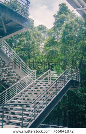 Metal Staircase Exterior of Modern Architectural Design Abstract Fragment against Green Trees Branches Background in the Garden in Open Air Space Middle of Sustainable Architecture Building Concept