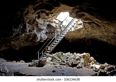 The metal staircase leading down to the inside of a lava tube cave in Oregon