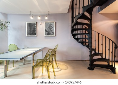Metal staircase and a plastic chairs and table