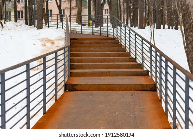 Metal stairs in the city. The path in the city is made of metal.