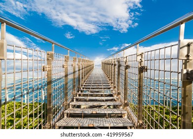 Metal stairs leading into the sky. perspective