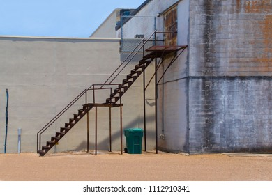 metal stairs leading to the second story of an old building