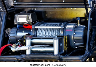 The metal steel cable of the electric winch is located on the front bumper of the cargo compartment of the equipped fire truck.