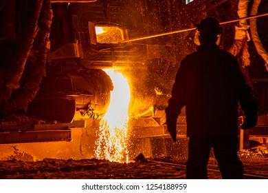 Metal steel worker working at hot firnace of metal steel plant