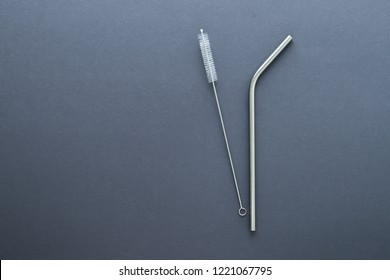 metal straw on gray background. flat lay top view. zero waste concept