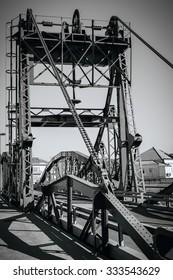 Metal structure elevation bridge over Sado river. Alcacer do Sal, Portugal. BW filtered shot