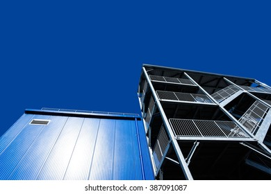 metal structure with a ladder on a background of blue sky