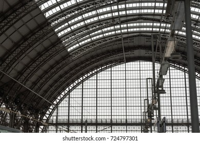 Metal structure of a  railway station's ceiling with lamps
