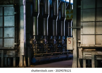 Metal structures and buildings of the old metallurgical plant inside and outside. Products of the metallurgical enterprise. Metallurgical industry