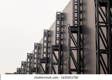 metal structures on the wall of a shopping center