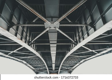 Metal structures under the bridge, large metal bridge over water