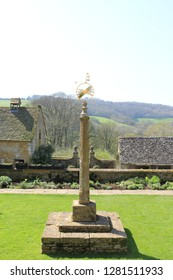 Metal sundial on a stone plinth from stately home grounds. Metal sundial on a stone plinth from the grounds of an English stately home.