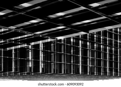 Metal supporting structures in darkness. Framework of modern building. Reworked photo of industrial architecture fragment. Construction industry. Abstract grid background.