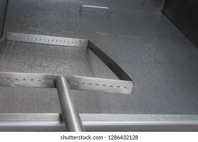metal surface for the curd cheese in a cheese factory with a objet to cut the curd inside the milk tank