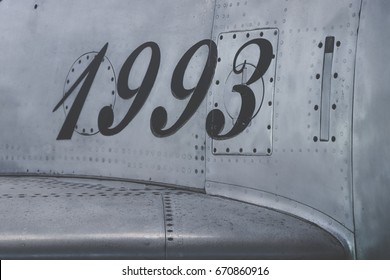 Metal surface from a jet fighter. fuselage of a airplane. With the 1993 year number