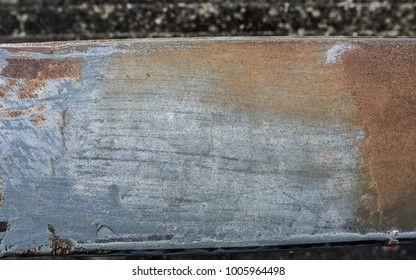 Metal surface with scratches and rust
