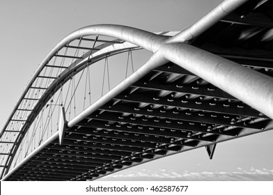 metal suspension bridge shot from worms-eye view. monochrome photo