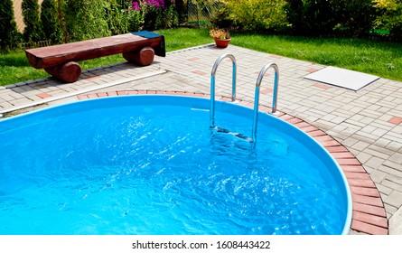 Metal swimming pool steps in the pool