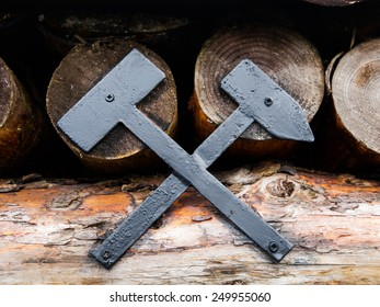 Metal symbol of minig industry at mine entrace