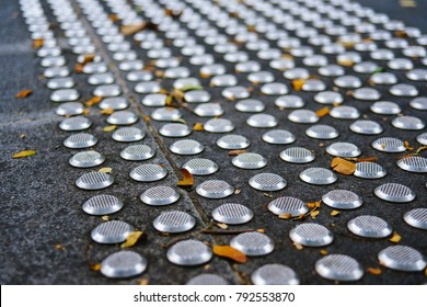Metal tactile paving tiles for the blind. Care for the disabled