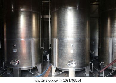 Metal tanks for white rum storage in a Caribbean distillery