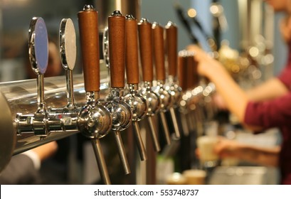 metal taps with the wooden handle for draft beer