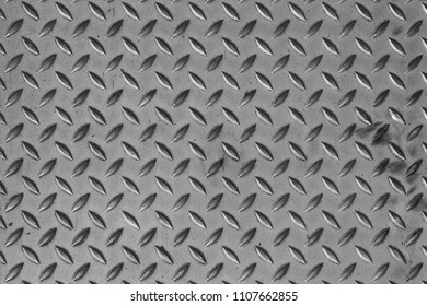 Metal texture for background, Diamond plate. Aluminium dark.