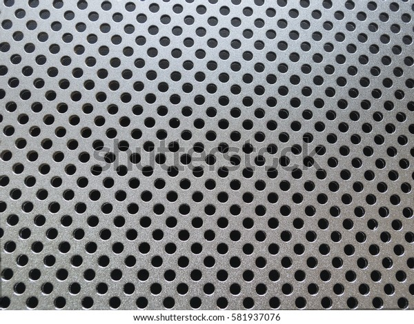 Metal texture or background with holes